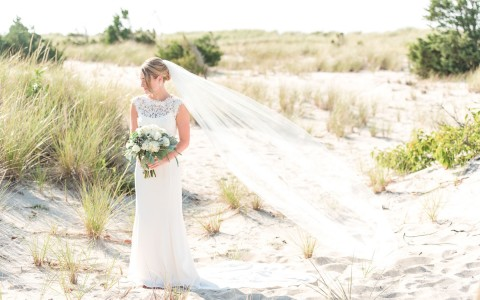bride posing the sand