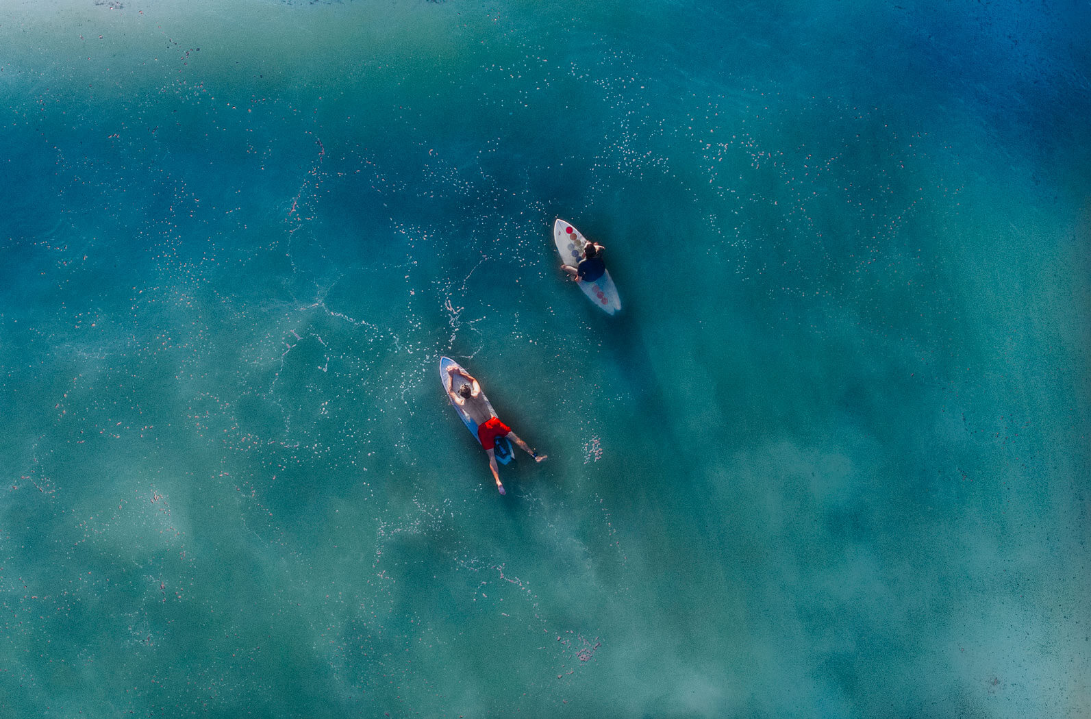 aerial view couple surfing