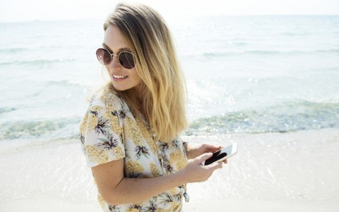 girl on beach pineapple print shirt