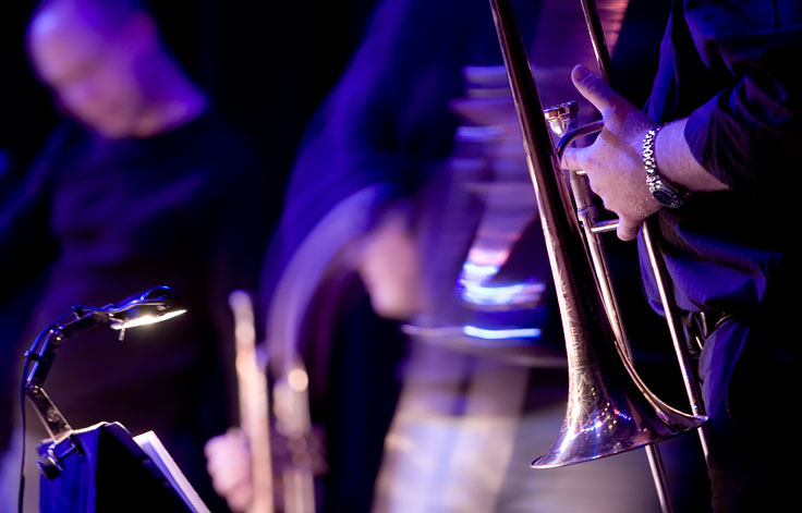 Close up of hands holding trombone