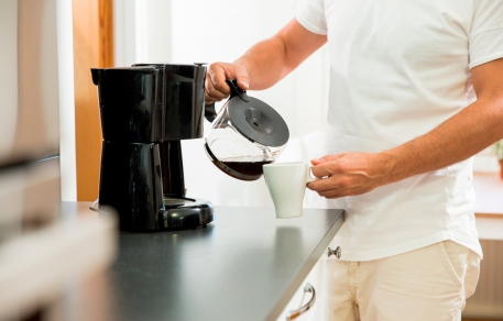 Man pouring coffee into cup