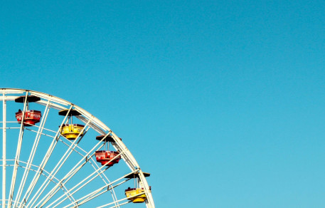 a ferris wheel and blue sky