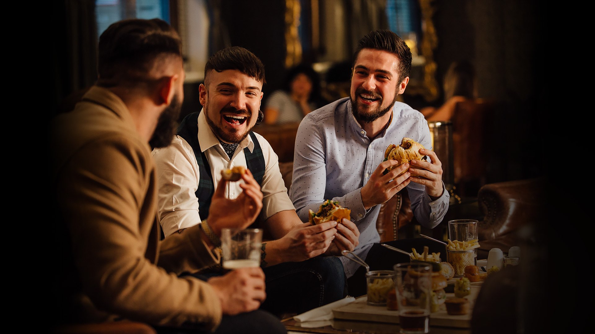 Group of guys enjoying appetizers