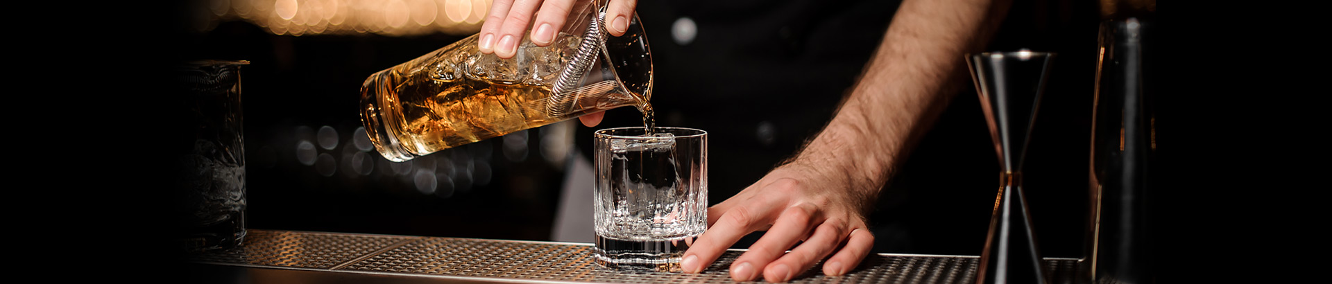 Close up of drink being poured into glass