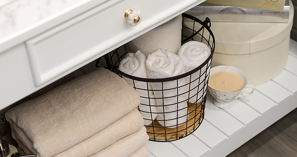 Towels in a basket under the sink