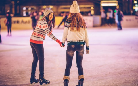 two girls ice skating