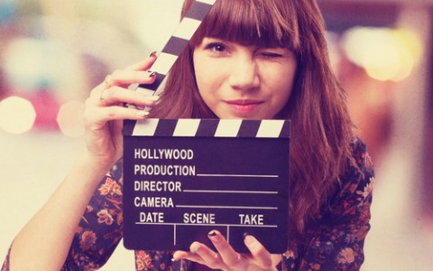 woman holding film clapper