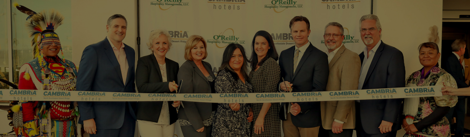 Group of associates posing at a Cambria ribbon cutting ceremony