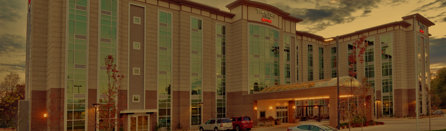 Panoramic shot of a TownePlace Suites hotel exterior