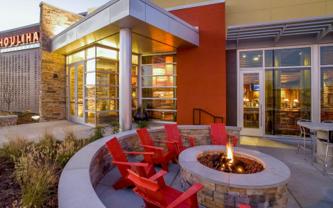 Houlihans Restaurant exterior with fire pit and chairs in front