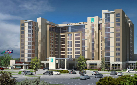 Rendering of Embassy Suites hotel exterior with Houlihans restaurant attached