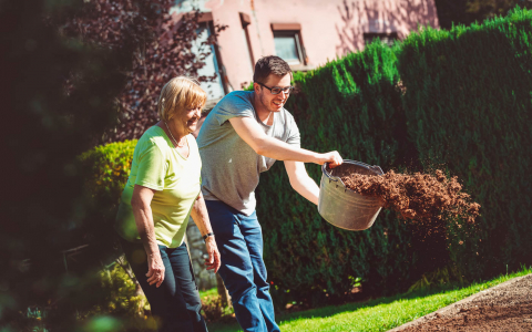 Woman and man on a lawn gardening