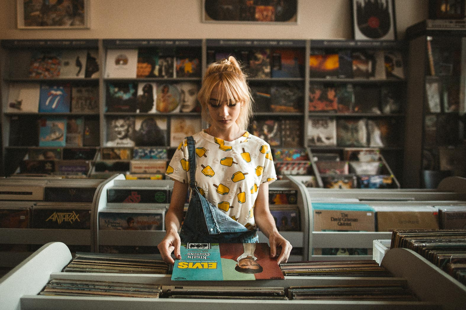 woman at a record store looking at records