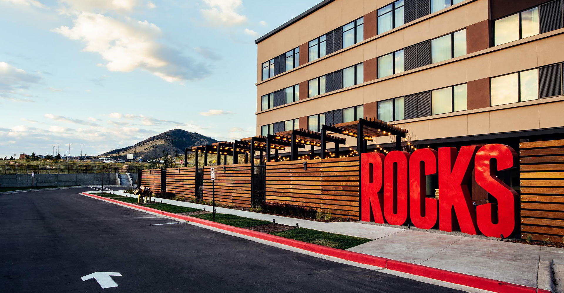 exterior of hotel with oversized sign that says Red Rocks
