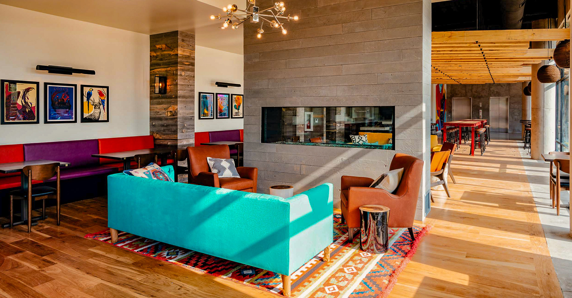 multicolored couches surrounding the lobby fireplace