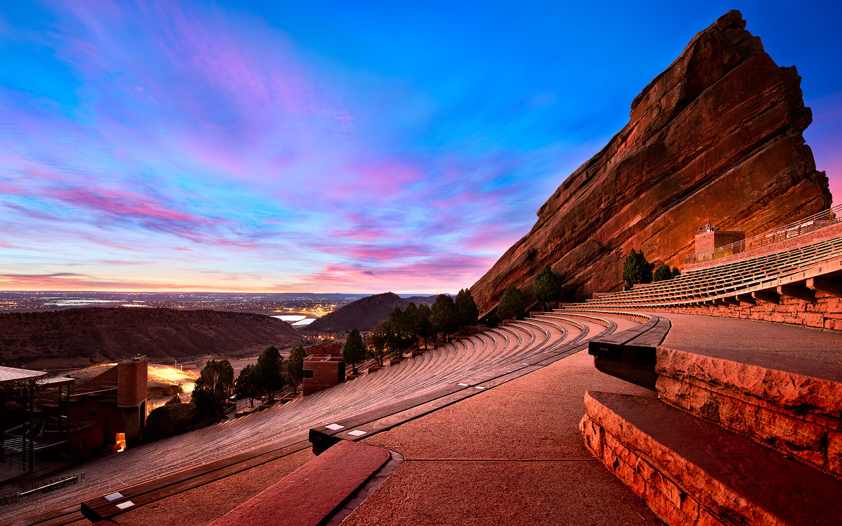 view of red rocks with a blue and pink sky