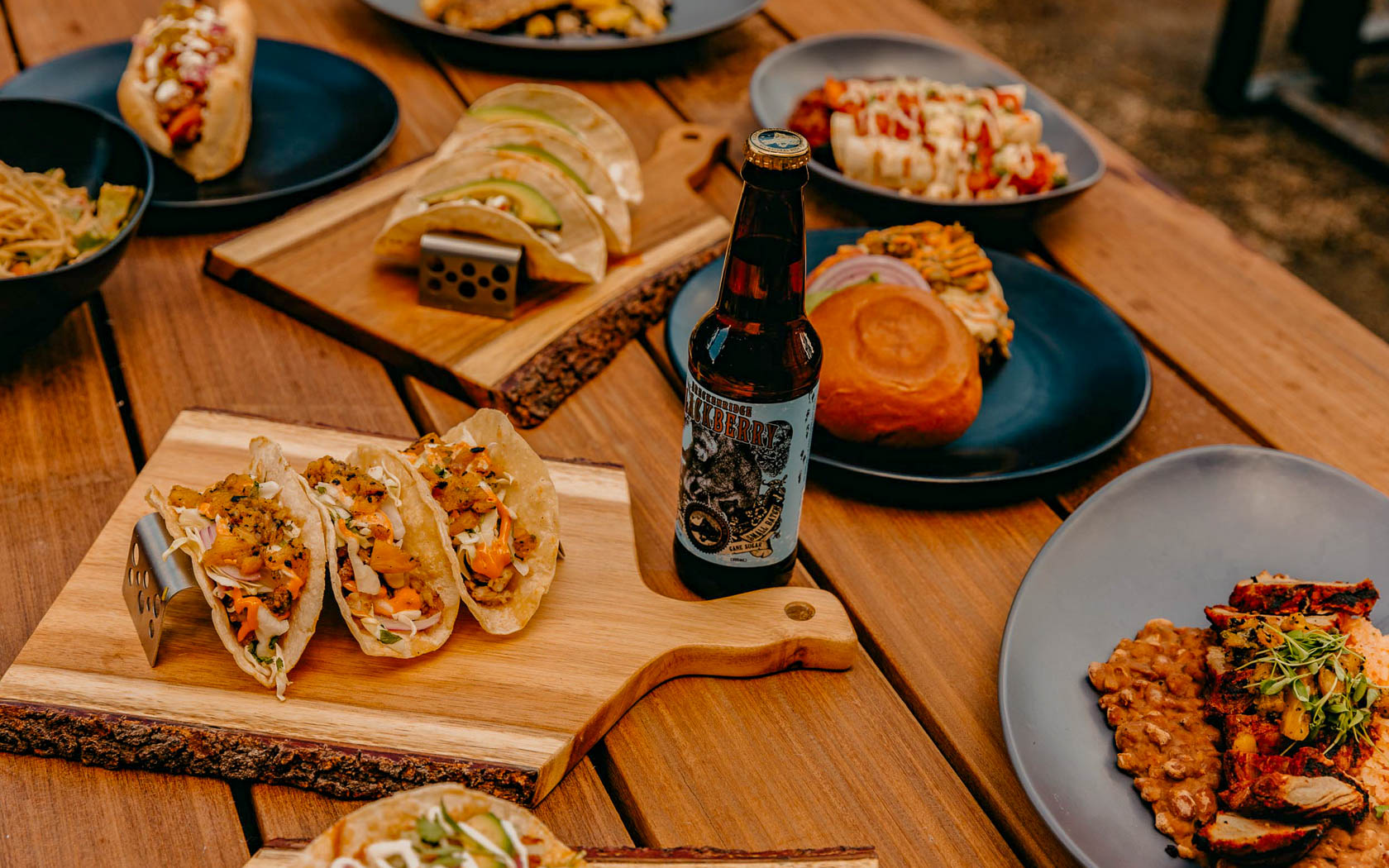 table with plates with tacos and beer
