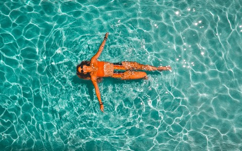 woman floating in pool water