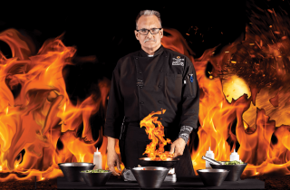 Chef with pots surrounded by fire