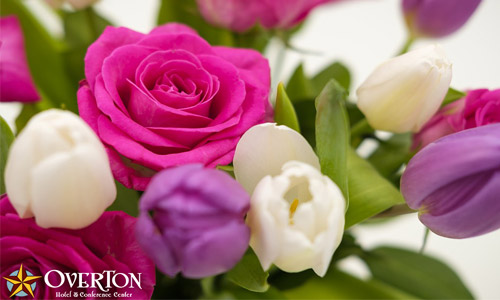 Bouquet of pink, purple, white flowers with the Overton logo on it