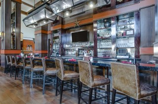 western themed long bar with bar stools