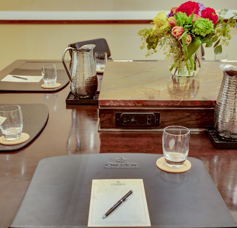 Conference Room Table Setting with notepad and pen