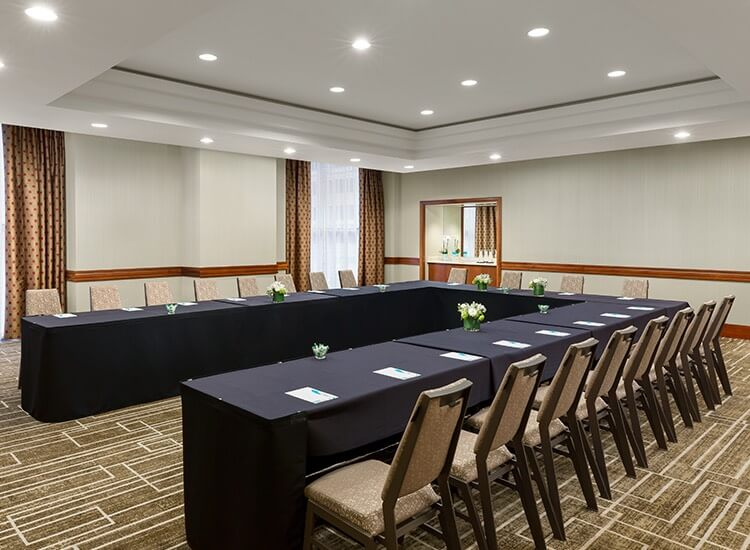 meeting room with chairs and tables set up
