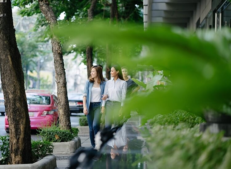 two women walking down the street in the city