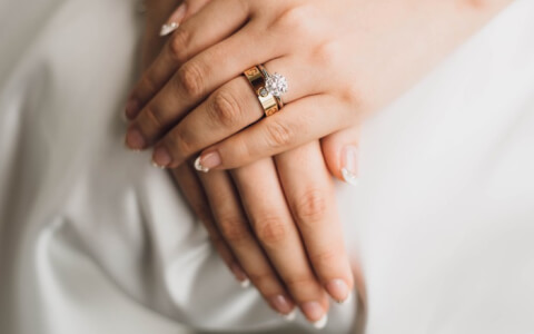 woman getting married showing her wedding ring