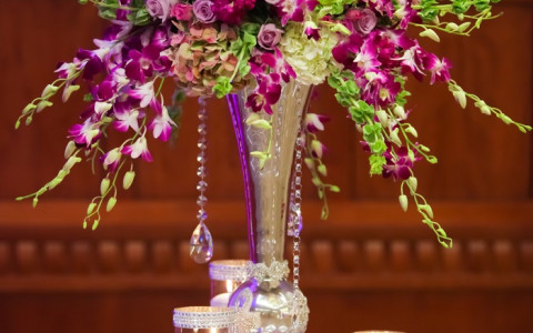 a purple and green wedding arrangement