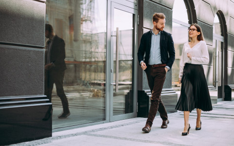 man and woman dressed for business