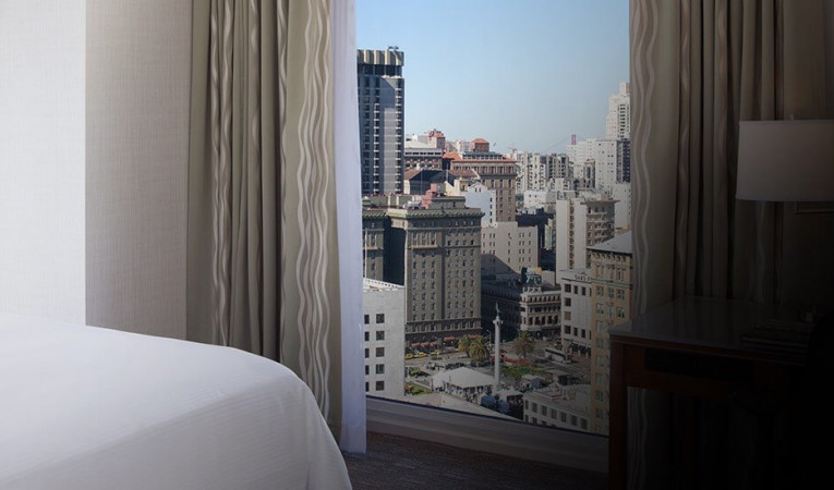 guest room with a view of the city