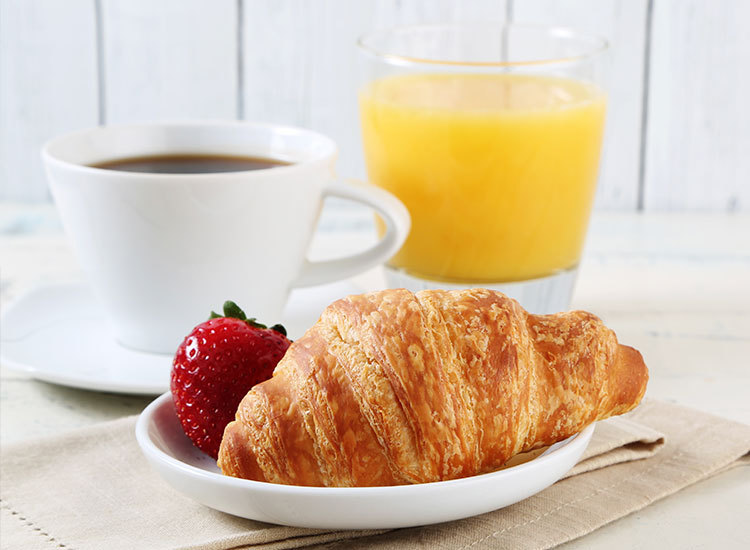 coffee with orange juice and pastry