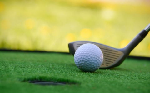 Close up of golf club next to golf ball