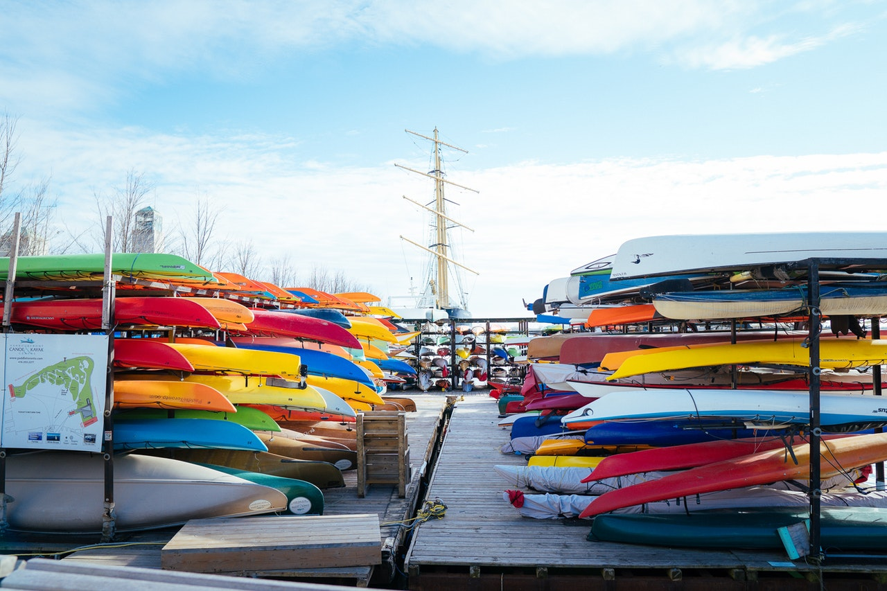 Colorful canoes stacked on the dock