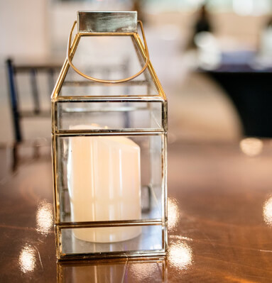 Close up of candle lantern on wooden table