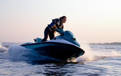 Woman riding jet ski on water