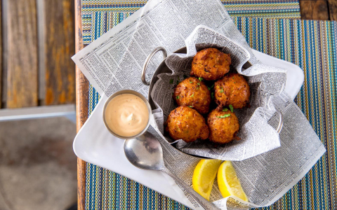 Fried crab balls with dipping sauce on the side