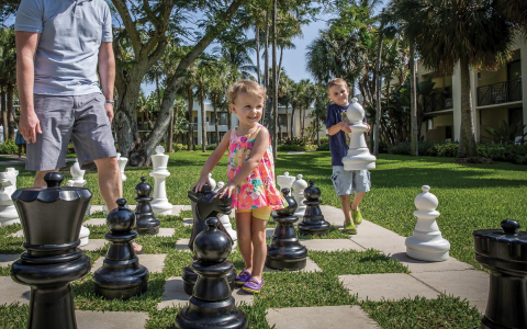 Kids playing life sized chess outdoors