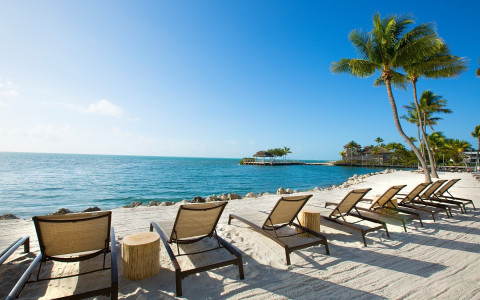 Pelican Cove lounge chairs by the water