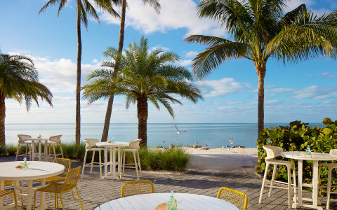 view of patio tables near the ocean