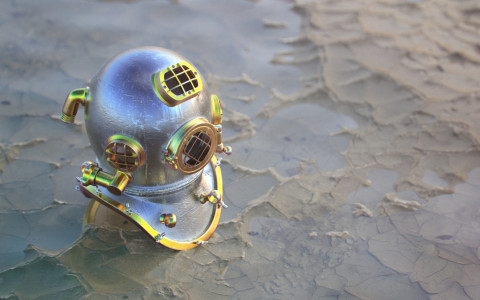 dive helmet on sand