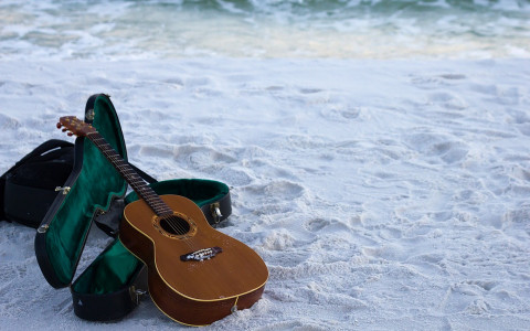 guitar in sand