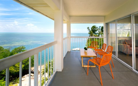 hotel room patio with ocean view