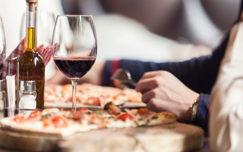 a pizza with red wine