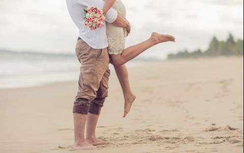 future bride and groom on the beach