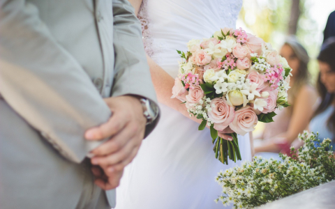 bride and groom with flower bouquet