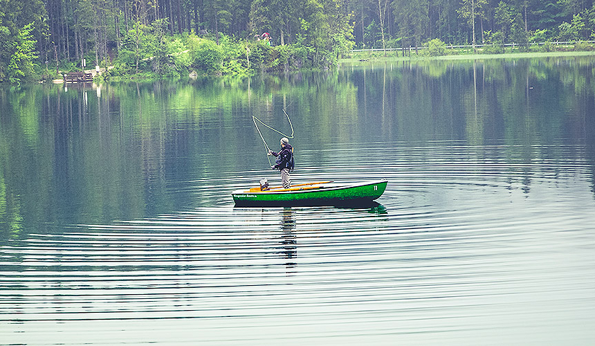 Fishing in lake in a boat on