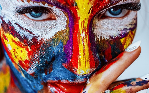 Woman with Face Painted in Vibrant Colors
