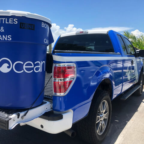 pick up truck with a 4Ocean branded trash can